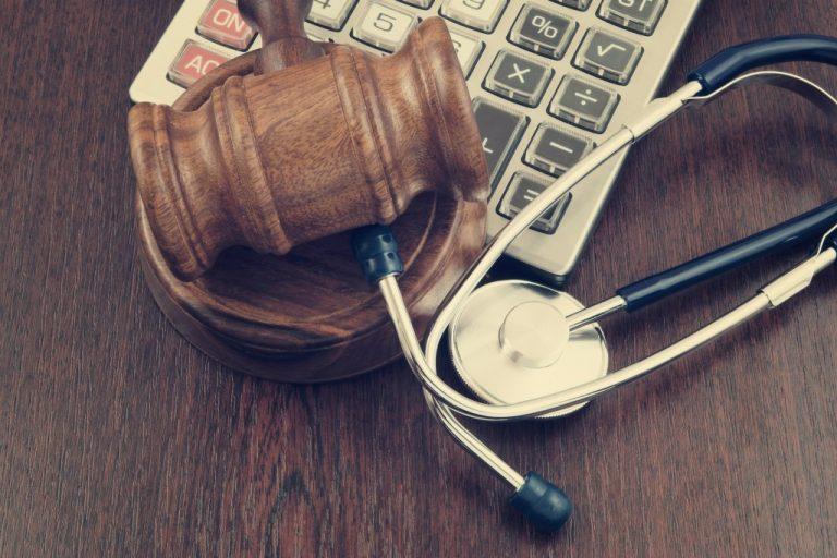 money, gavel, and stethoscope