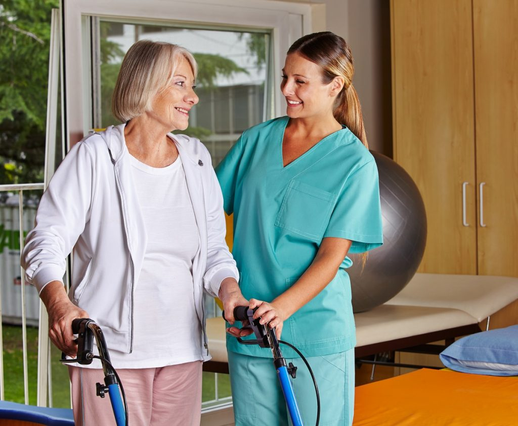 nurse helping and elderly woman