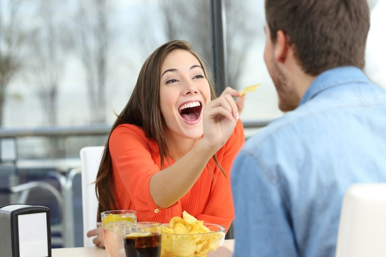 woman feeding her date