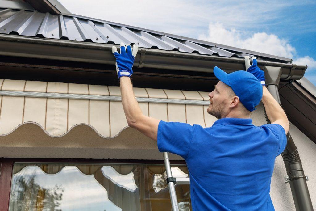 contractor installing gutter