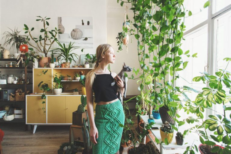 Female in room full of plants