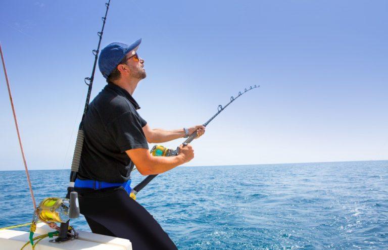 man fishing in the ocean