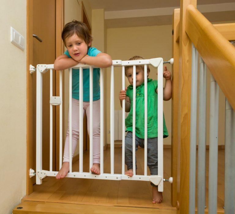 toddlers with safety gate