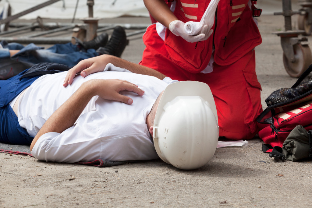 person administering first aid
