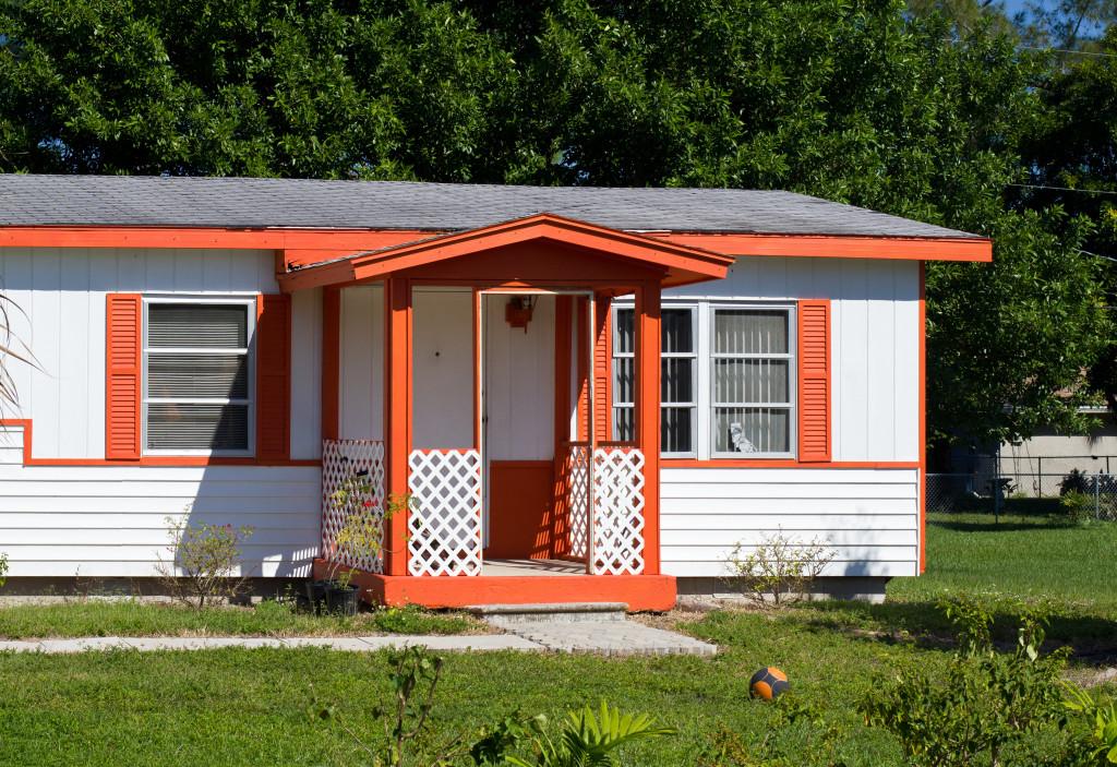 House with orange window shutters